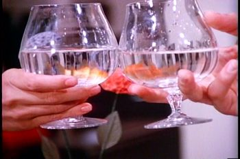 water glasses with goldfish